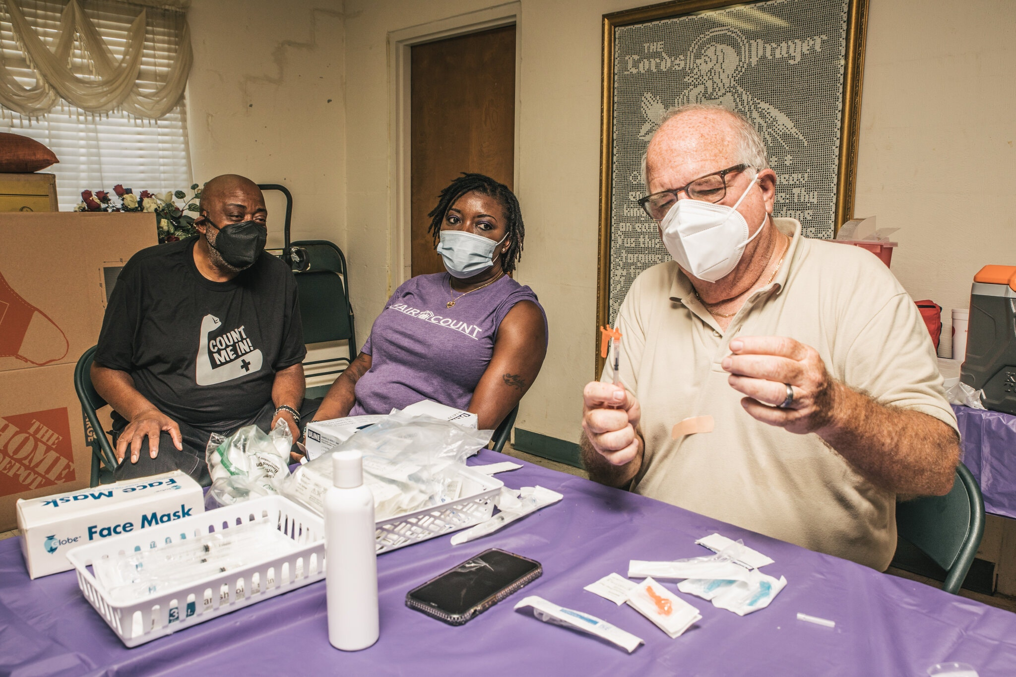 A vaccine being prepared at the Grant Chapel AME Church in Moultrie, Ga, organized through the Count Me In initiative, on Saturday. Credit Matthew Odom for The New York Times
